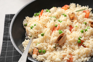 Dish with delicious seafood risotto, closeup