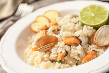 Plate with delicious seafood risotto, closeup