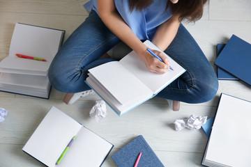 Female student preparing for exam indoors