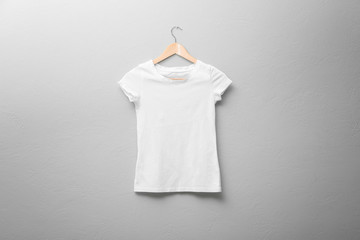 White t-shirt on light background. Mock up for design