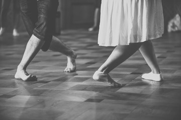 Feet of two dancers. Black and white vintage style pgoto.