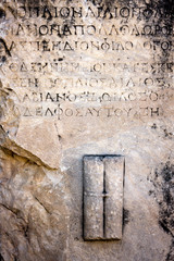 Ancient background, greek text letters carved in stone. Selcuk / Turkey
