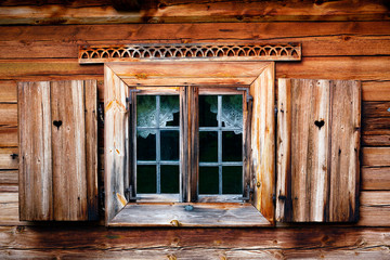 Old windows with shutters. Rustic wooden house