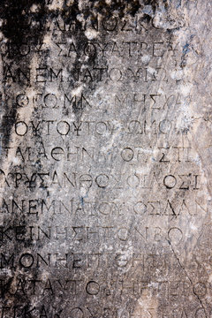 Ancient Greek text background. Letters carved in stone. Selcuk in Turkey