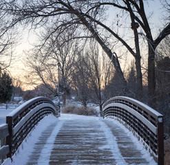 Freshly Plowed Footbridge at Sunrise After Winter Snowstorm