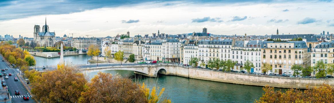 Panorama of Notre-dame-de-Paris and Seine river in autumn