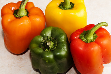 Four Bell Peppers Green Red Yellow Orange Together