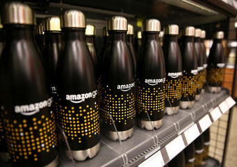 Water bottles with the Amazon Go logo are for sale in the new Amazon Go store in Seattle