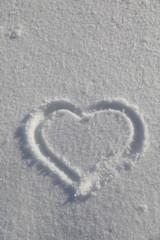 Heart symbol on snow background