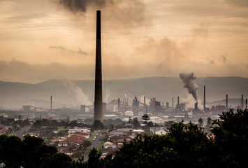 High view across industrial town to steel works smoke stack