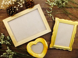blank photo frames on the table wooden background