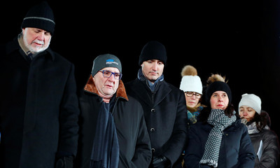 Canada's Prime Minister Justin Trudeau and Quebec's Premier Philippe Couillard look on during the one-year anniversary vigil for the victims of the fatal shooting at the Centre Culturel Islamique de Quebec in Quebec City, Canada