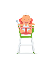 Cute baby sits on a high chair and holds a spoon. Baby healthy feeding concept.