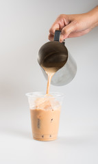 Iced tea or coffee with milk on a background.