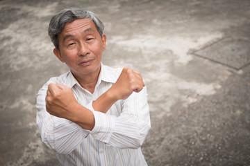 senior old man crossing arm saying no, rejecting gesture
