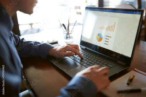 Close Up Back View Of Caucasian Businessman Hands Typing On Laptop
