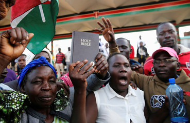 Supporters of Kenyan opposition leader Raila Odinga of the National Super Alliance (NASA) coalition hold a Bible ahead of his planned swearing-in ceremony as the president of the people's assembly in Nairobi