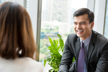 Happy businessman laughing during the meeting