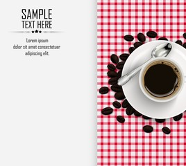 Cup of coffee with coffee beans and spoon on a tablecloth background