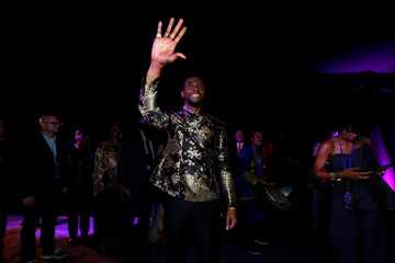 "Cast member Boseman waves at fans at the premiere of ""Black Panther"" in Los Angeles"
