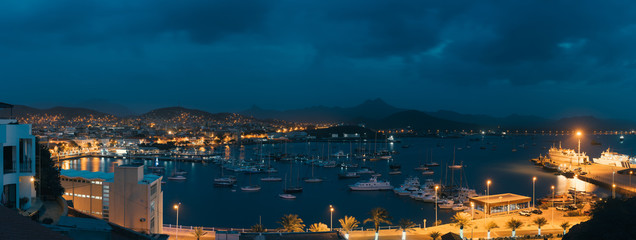 Mindelo in twilight. Port town with many boats in the bay on the Cape Verde in the northern part of the island Sao Vicente. Long exposure panoramic shot Fototapete