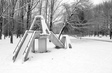An old soviet playground for children in winter
