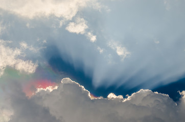 Nice dramatic sky, Iridescence over clouds with sun ray shine in blue sky background