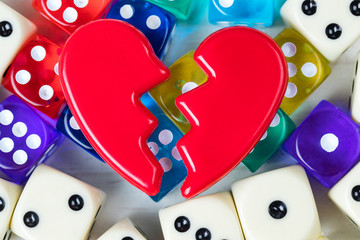 Broken red Valentines Day heart on a game dice.