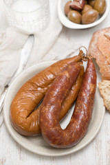 smoked portuguese sausages on white plate