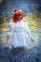 Beautiful woman bathing in a beautiful river