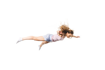 full length view of young woman falling and looking down isolated on white Wall mural