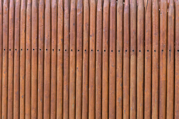 planks fence dyeing with brown paint and brush .