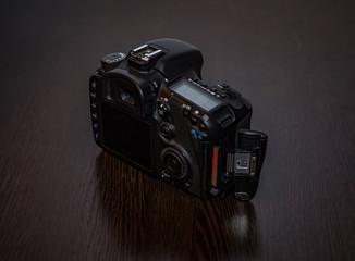 A digital SLR camera lies on a table