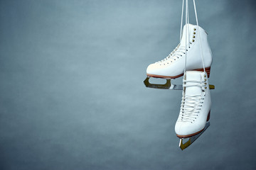 Women's skates with laces on a gray background.
