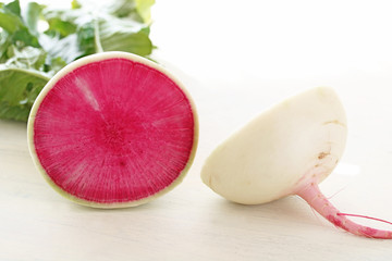 Tasty watermelon radish on white wooden background紅芯大根