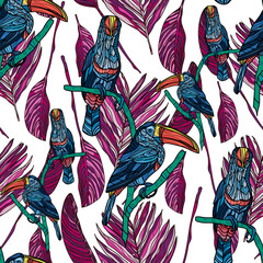 Seamless pattern with toucans and tropical leaves.