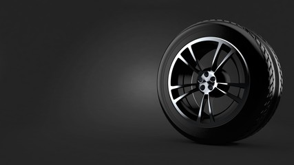 Car tire on gray background