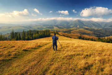 autumn morning. dawn in the Carpathian mountains. photographer, taking off the dawn. man in the mountains
