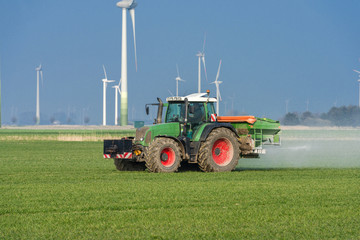 Tractor with fertilizer spreader on the field  - 8941