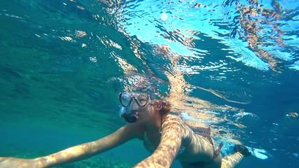 Wall Mural - girl teenager and snorkeling