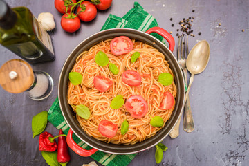 Spaghetti pasta with tomato sauce  and fresh basil - homemade healthy italian pasta on rustic wooden background