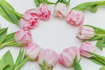 Pink tulips flatlay on the marble background with copy space