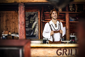 Bavarian man and his own small business. Grill bar interior.