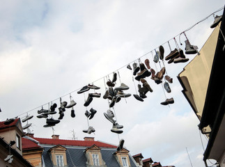 lota of hanging shoes from a line