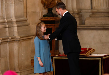 """Spain's King Felipe presents his daughter Princess Leonor with the insignia of the """"Toison de Oro"""" (Order of the Golden Fleece) during a ceremony at the Royal Palace in Madrid"""