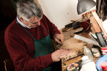instrument maker working in his workshop