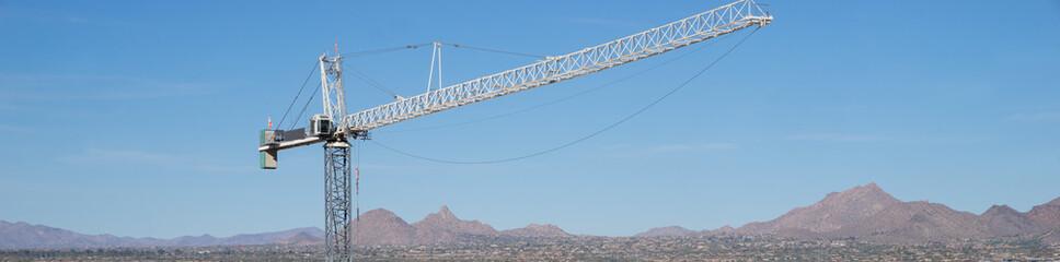 Giant crane with desert mountain background,Scottsdale,Az