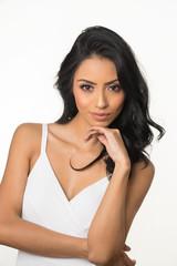 Beautiful woman with long dark hair wearing white dress