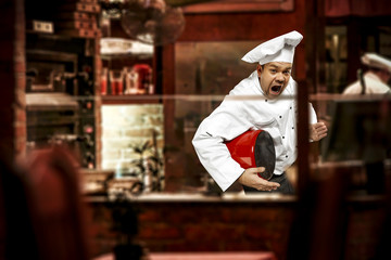 Cook chef in his own small business of restaurant.