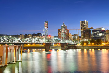 Portland night skyline along city river, Oregon